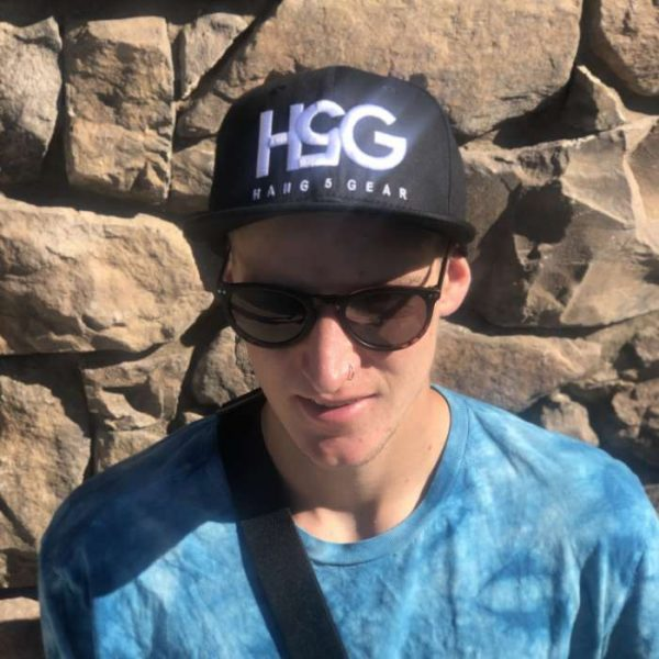 man wearing black hat with h5g brand
